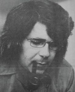 Man approximately 30 years old with glasses and a pipe