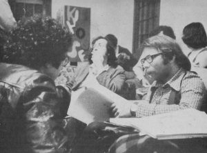 1970s meeting with 3 men sitting in front