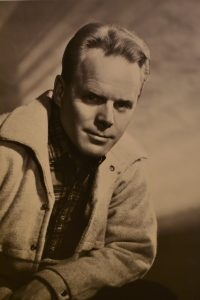 vintage 1950s head and shoulders photo of middle-age male with blond hair