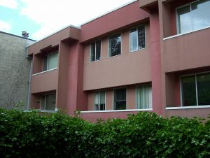 Brick -coloured two story apartment building, circa 1980s