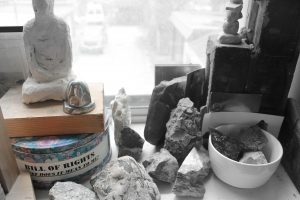 photo of assorted rocks and objects on window sill
