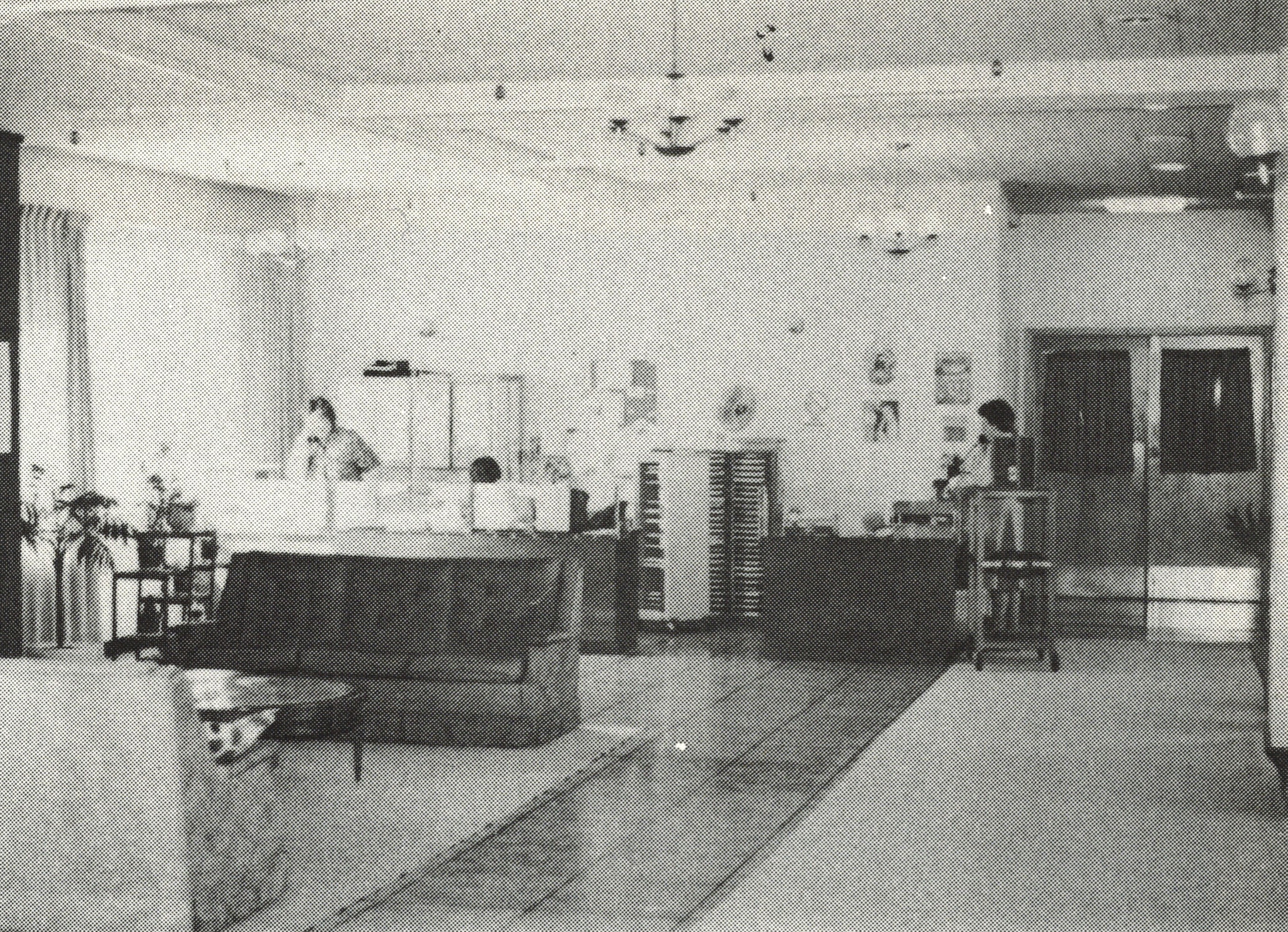 black and white interior shot of living room area, circa 1960s or 1970s