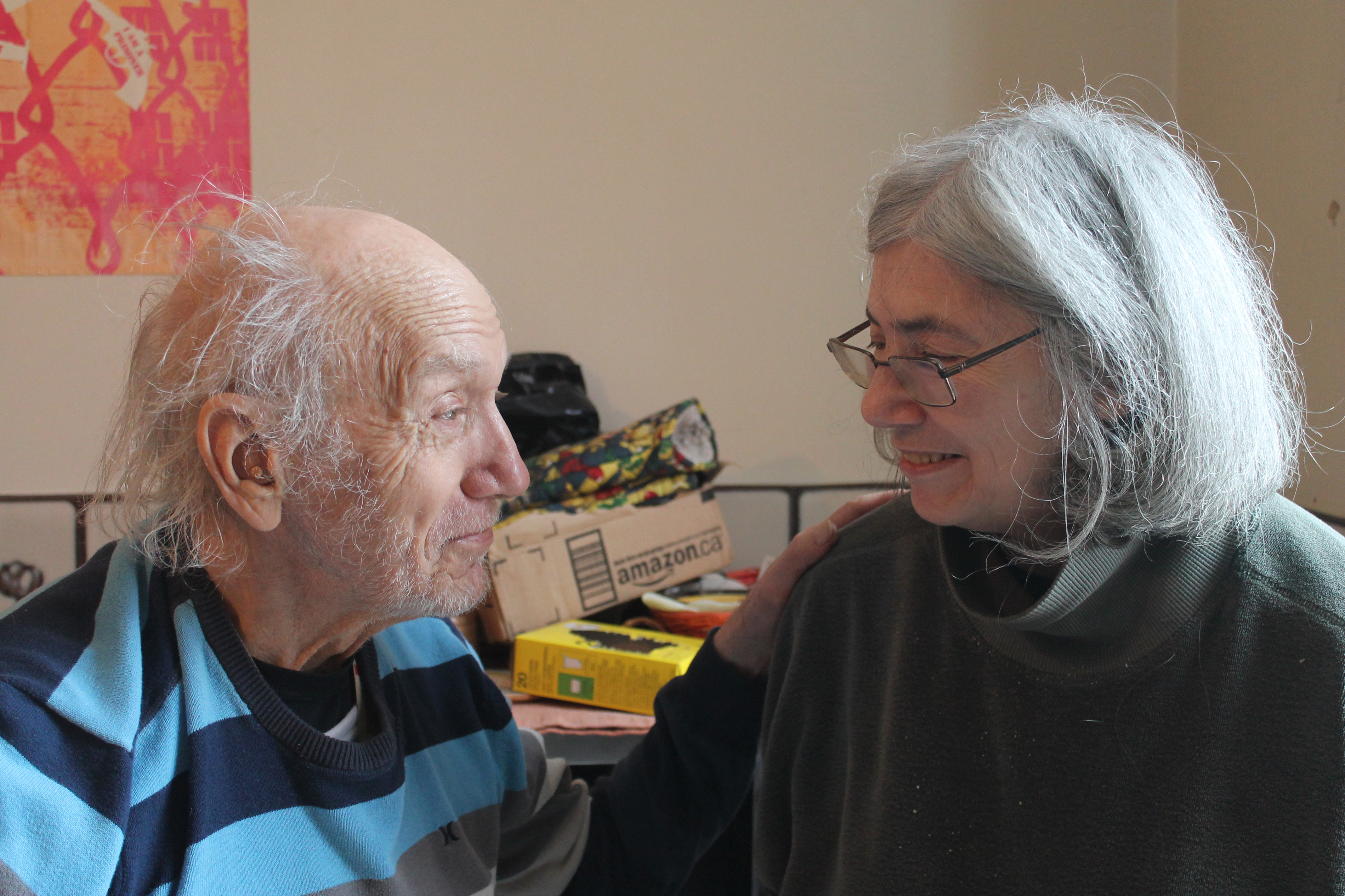 older white haired man on left and grey haired woman with glasses on right