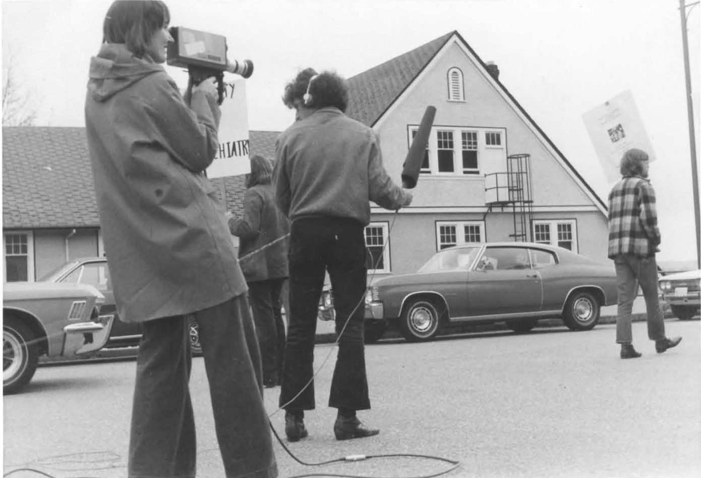 series of photos of 1970s protestors caring signs. Photo of press with camera and recording equipment.