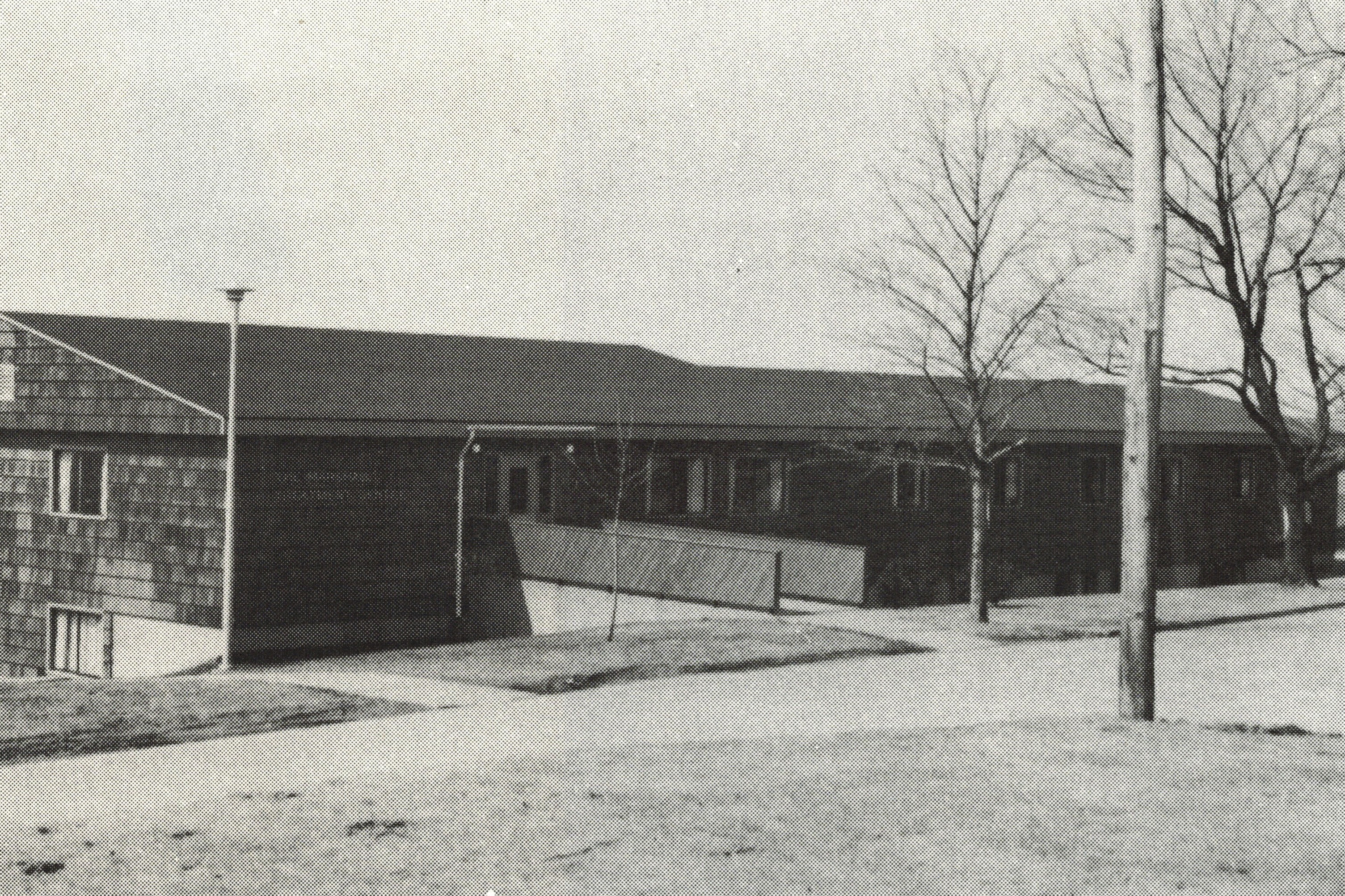 old black and white photo of low-rise wooden building