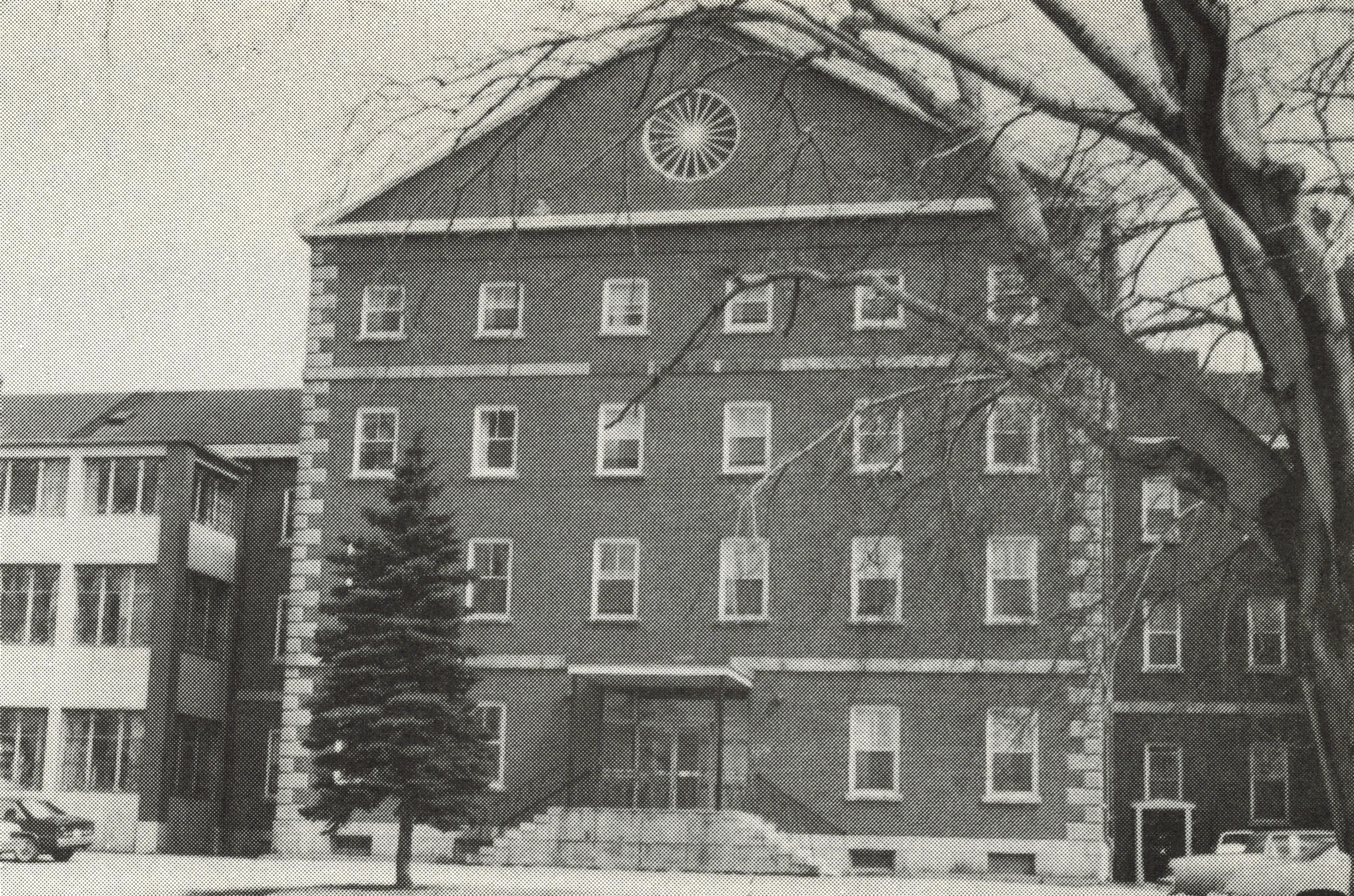 black and white photo of older multi-story institutional building