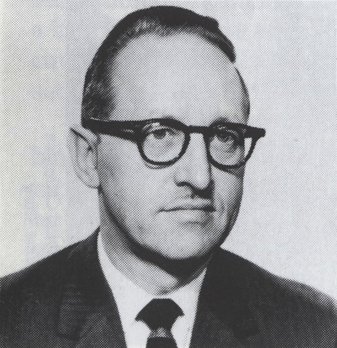 old black and white photograph, 1950s of man with dark hair and glasses