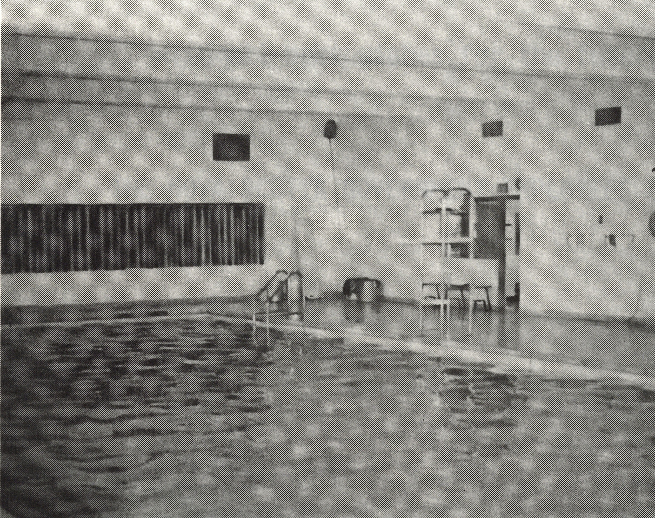 black and white photo of empty swimming pool