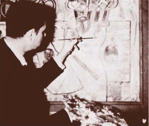 Photo en noir et blanc d'un homme peignant un tableau