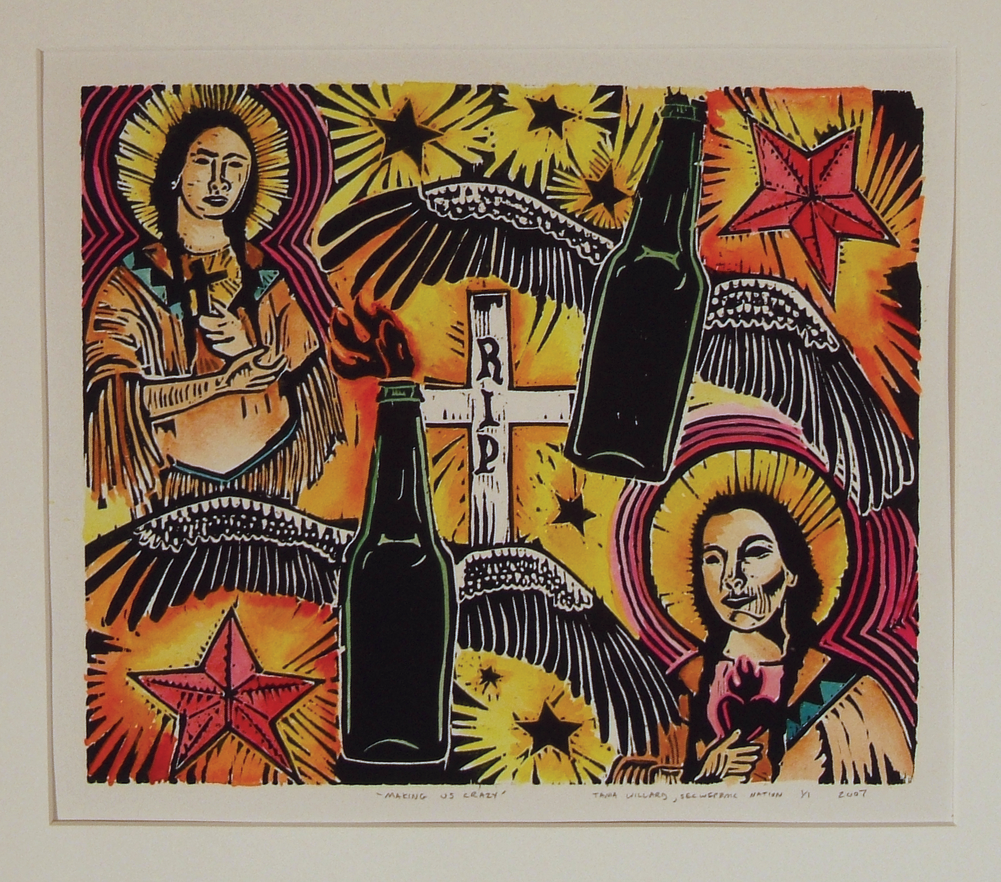 multi-coloured print with religious symbols, gravemarker, bootles, wings and stars