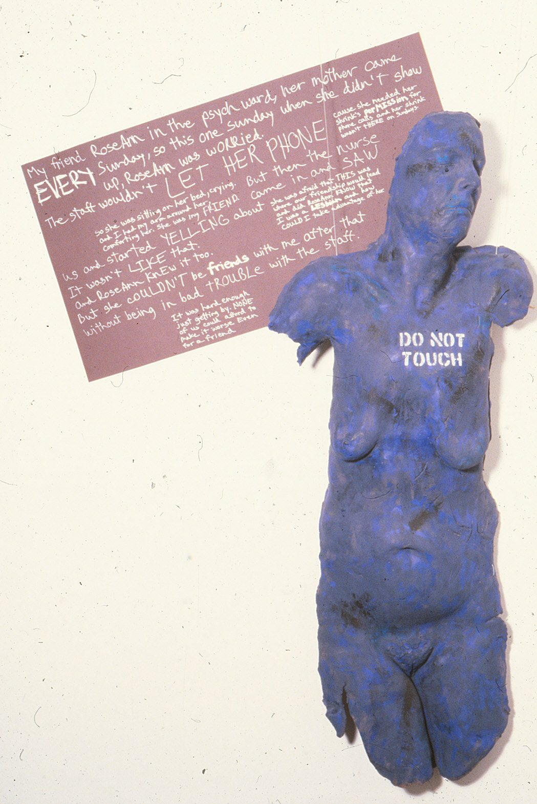 blue woman's torso with writing behind and on her chest