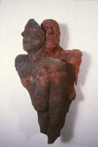 2 female torsos in dark colours