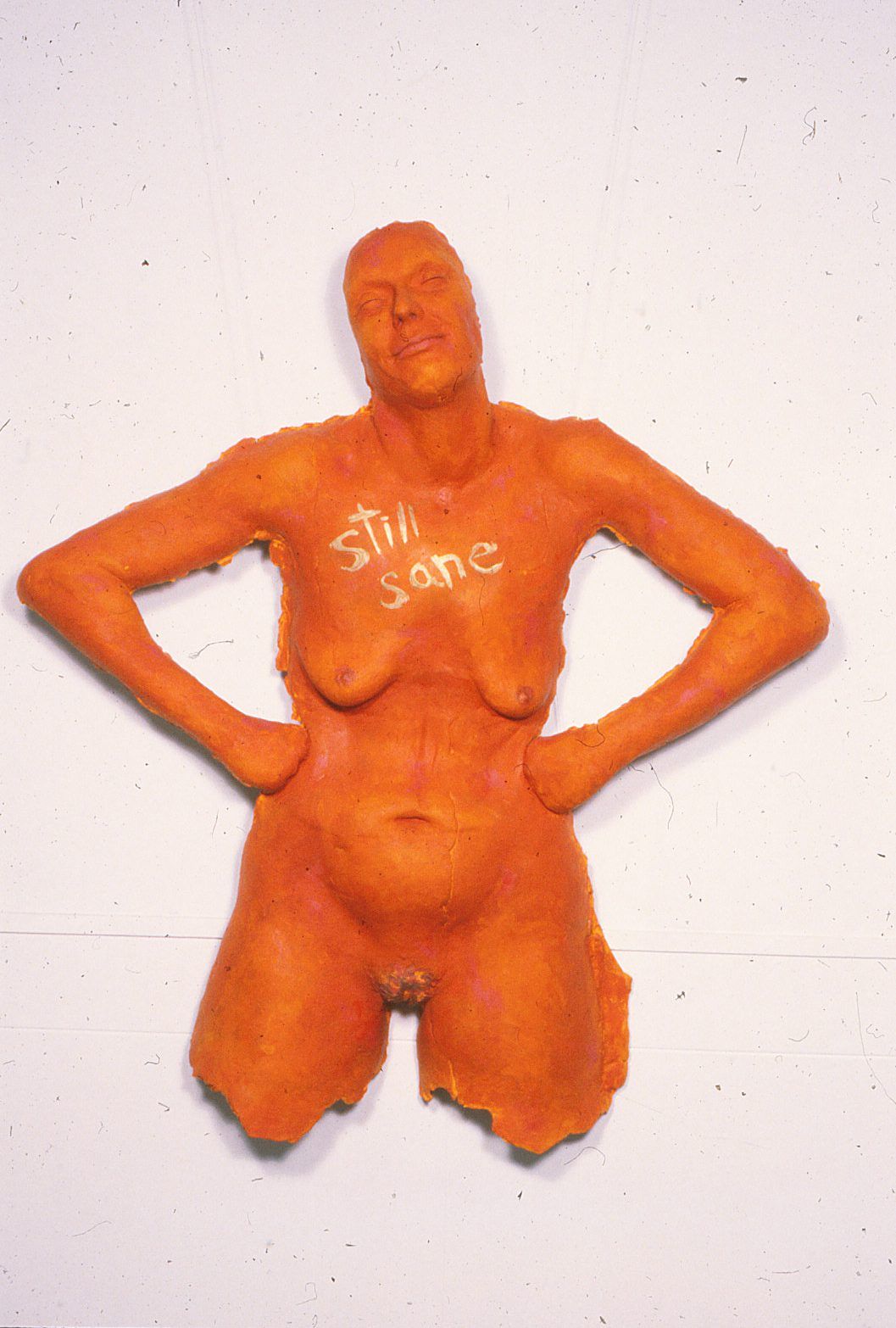 naked woman standing with the hands on her hips